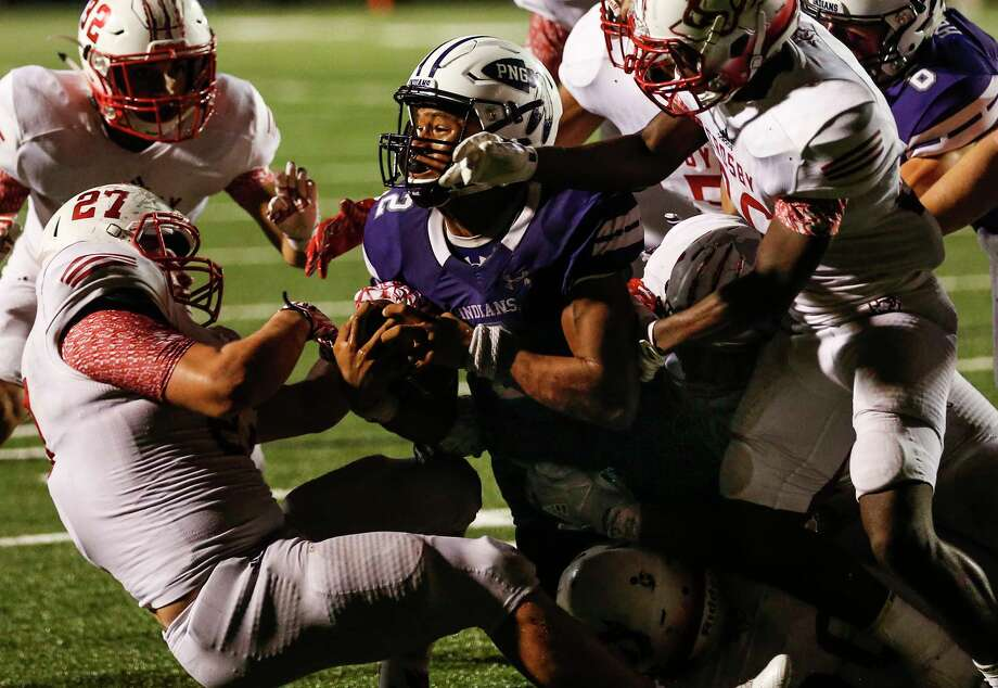 Port Neches-Groves quarterback Roschon Johnson dives into the end zone over Crosby linebacker Hunter Bailey (27) for a 2-yard touchdown, and game winning run, during the fourth quarter of a Class 5A bi-district playoff football game at Stallworth Stadium on Friday, Nov. 17, 2017, in Baytown. Port Neches-Groves advanced in the playoffs with a 72-69 win. ( Brett Coomer / Houston Chronicle ) Photo: Brett Coomer, Staff / © 2017 Houston Chronicle