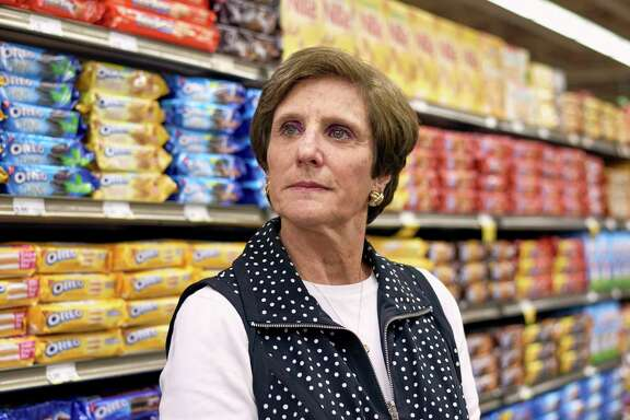 Irene Rosenfeld, retiring chief executive of Mondelez International, checks out a snack food aisle at a store in Northbrook, Ill.