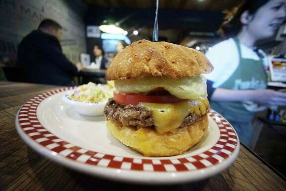 A 100 percent U.S. Angus beef Colby Jack cheeseburger was served to President Donald Trump at Munch's Burger Shack in Tokyo.