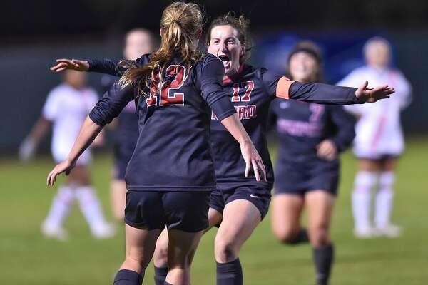 Stanford's Kyra Carusa (12) and Andi Sullivan celebrate Carusa's goal against Auburn.