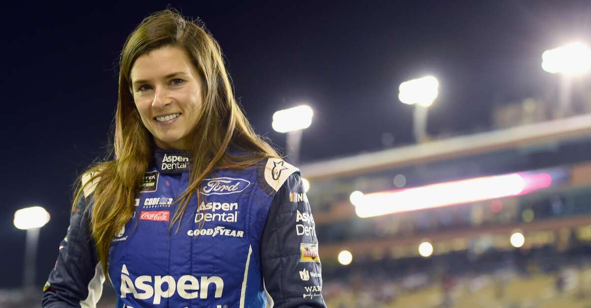 HOMESTEAD, FL - NOVEMBER 17: Danica Patrick, driver of the #10 Aspen Dental Ford, stands on the grid during qualifying for the Monster Energy NASCAR Cup Series Championship Ford EcoBoost 400 at Homestead-Miami Speedway on November 17, 2017 in Homestead, Florida. (Photo by Jared C. Tilton/Getty Images)