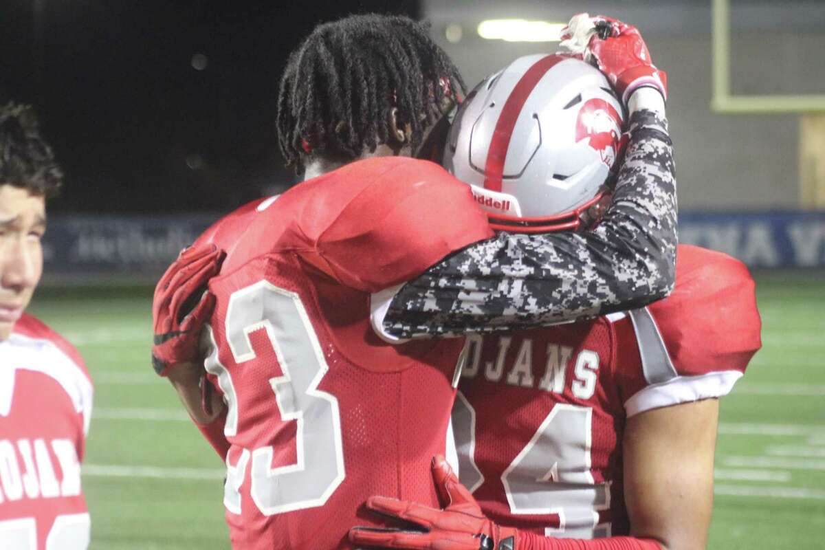 Jason Hampton and Ethan Ponce console each other, following Friday night's 28-21 loss to Kingwood in the bi-district playoffs.