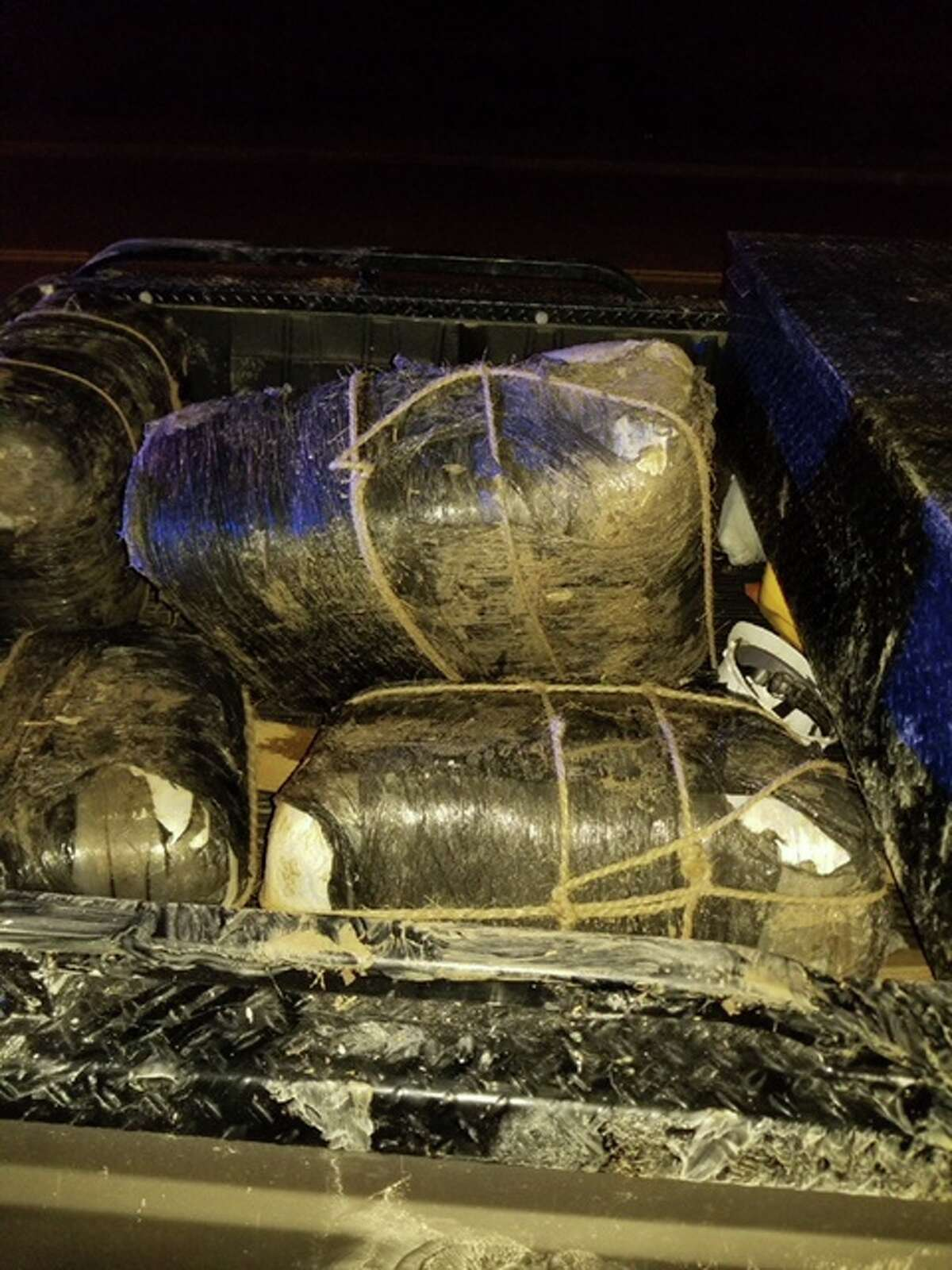 Border Patrol agents discovered numerous people loading nine bundles of marijuana into a Ford F-250 pickup truck.