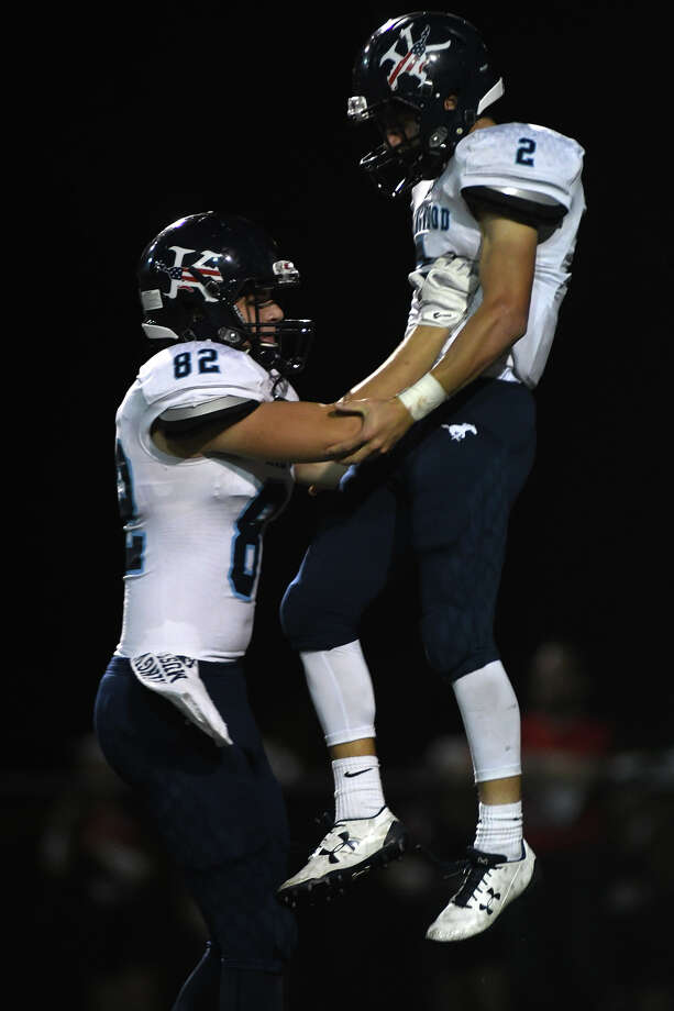 Kingwood junior tailback Blake Parr (2) celebrates his 2nd quarter touchdown with teammate Liam Westwood (82) against South Houston during their opening round playoff game at Pasadena Veteran's Memorial Stadium in Pasadena on Nov. 17, 2017. (Photo by Jerry Baker/Freelance) Photo: Jerry Baker, Freelance / Freelance