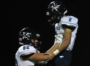 Kingwood junior tailback Blake Parr (2) celebrates his 2nd quarter touchdown with teammate Liam Westwood (82) against South Houston during their opening round playoff game at Pasadena Veteran's Memorial Stadium in Pasadena on Nov. 17, 2017. (Photo by Jerry Baker/Freelance)