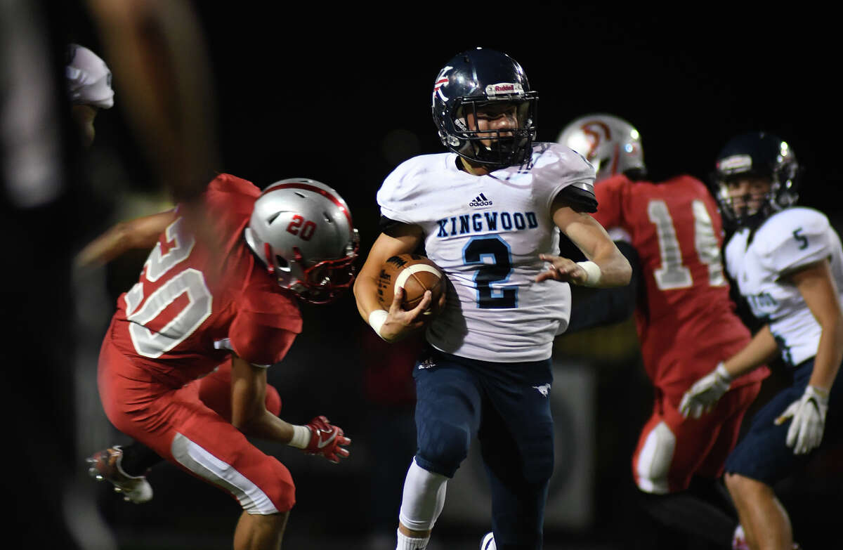 Kingwood junior tailback Blake Parr (2) runs past South Houston senior defensive back Ramiro Fuentes (20) during second quarter action of their opening round playoff game at Pasadena Veteran's Memorial Stadium in Pasadena on Nov. 17, 2017. (Photo by Jerry Baker/Freelance)