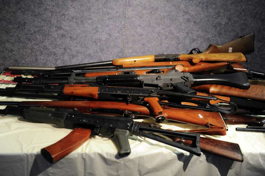Rifles, including an AK-47, turned in during a gun buyback event at the Bridgeport Police Department's Community Services Division Friday, Dec. 28, 2012 in Bridgeport, Conn. In the wake of the tragedy in Newtown, Conn., the city raised $100,000 for the program and will offer up to $200 value for a working handgun, $75 for rifles and higher amounts for assault-type rifles.  The buy back will continue every Saturday until the city gives out all of the funds which includes an additional $10,000 in gift cards from the Food Bazaar grocery store. Photo: Autumn Driscoll / Staff File Photo / Connecticut Post