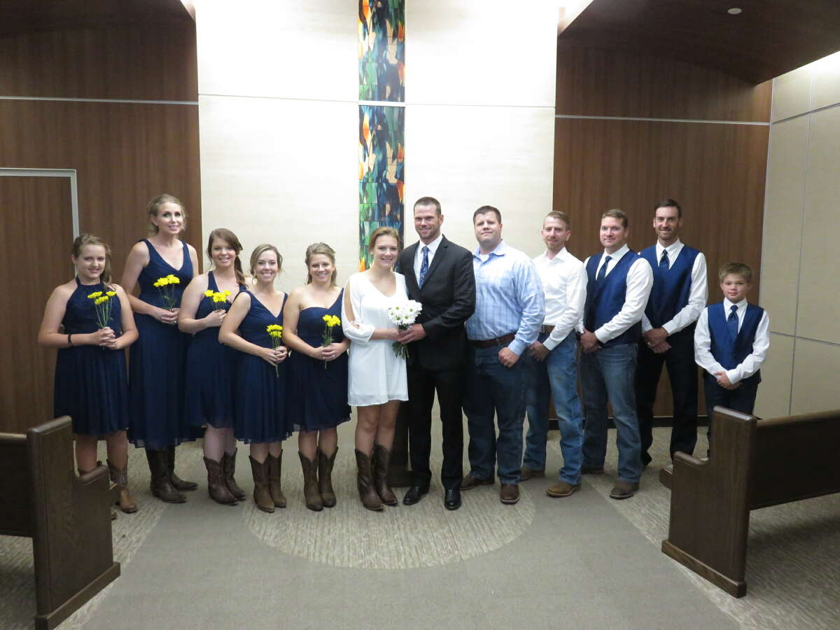 Newlyweds Andrew and Kelly Blombergat Memorial Hermann Cypress.