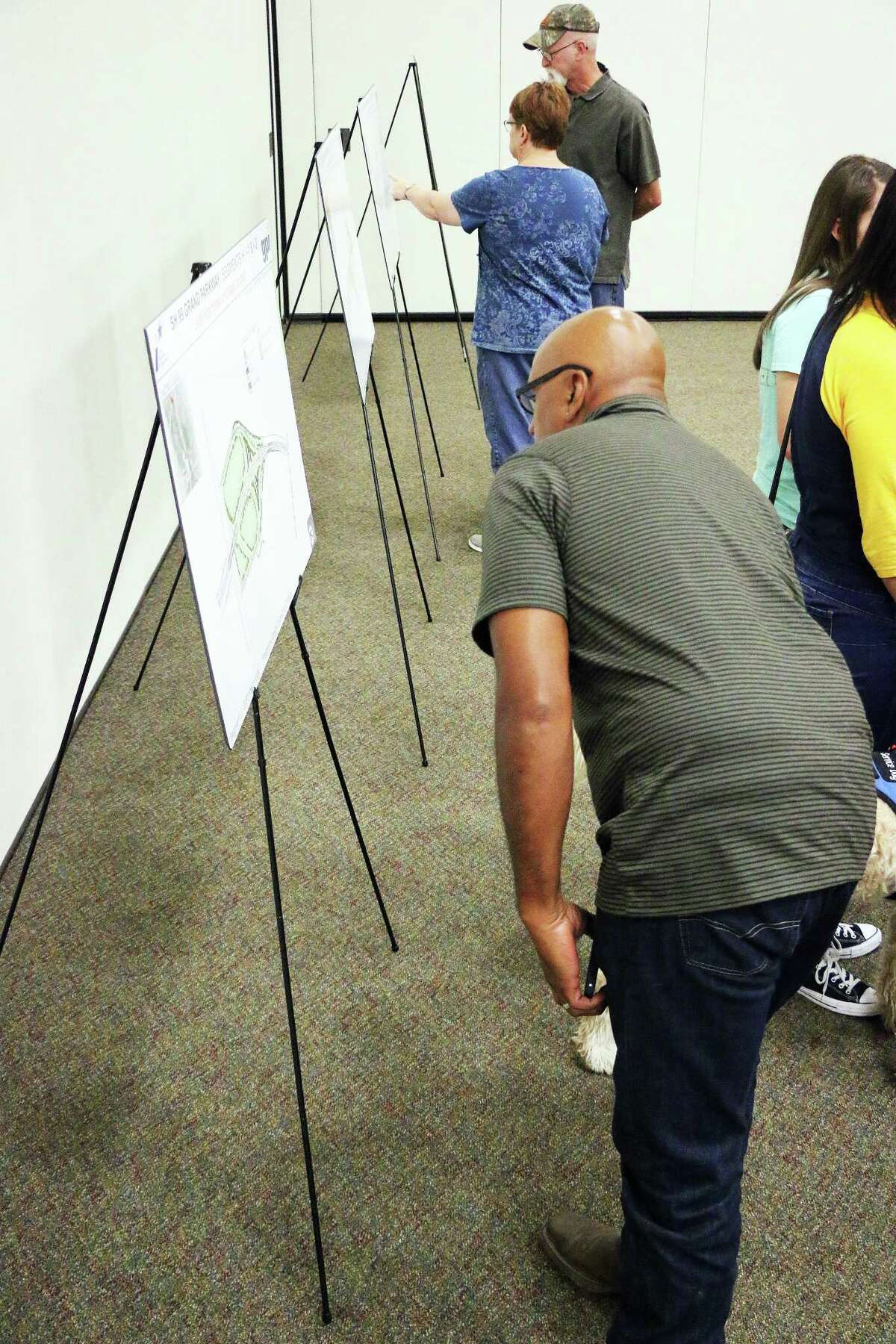 Residents took the time to study the storyboards set up in the ball room at the Dayton Community Center last Tuesday.