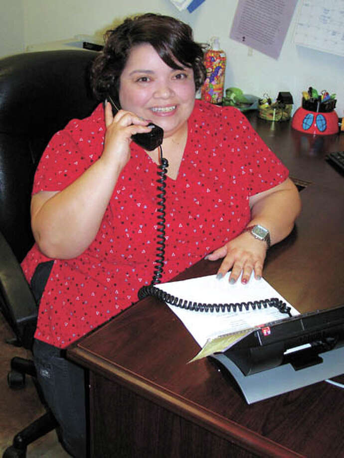 On a typical day, here's how you'll see St. Joseph's Estella Guevara—on  the phone, making sure clients get the best care possible. Call St.  Joseph's at 432-684-5858 today. Photo: Paul Wiseman