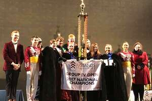 The Newtown High School Nighthawks Marching Band & Guard officers accept the National Championship award.