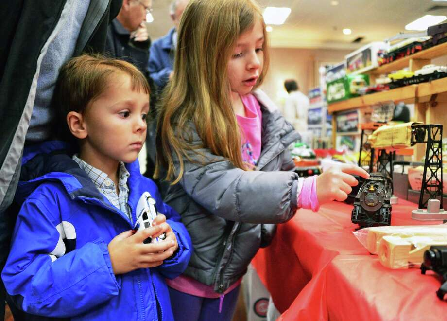 Six-year-old Ella Behrens of Valatie, right, teaches her brother Connor, 4, a little about trains during Vintage Trains' annual Albany Train Show Saturday Nov. 18, 2017 in Albany, NY.  (John Carl D'Annibale / Times Union) Photo: John Carl D'Annibale / 20042162A