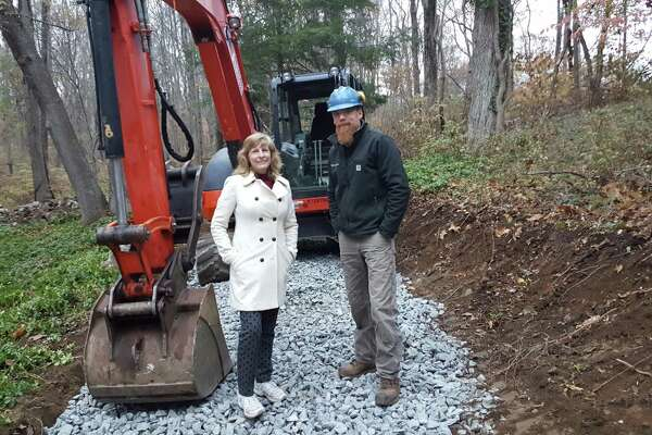 Pat Sesto, president of Friends of the NRVT, and Josh Ryan, Timber & Stone trail builders.