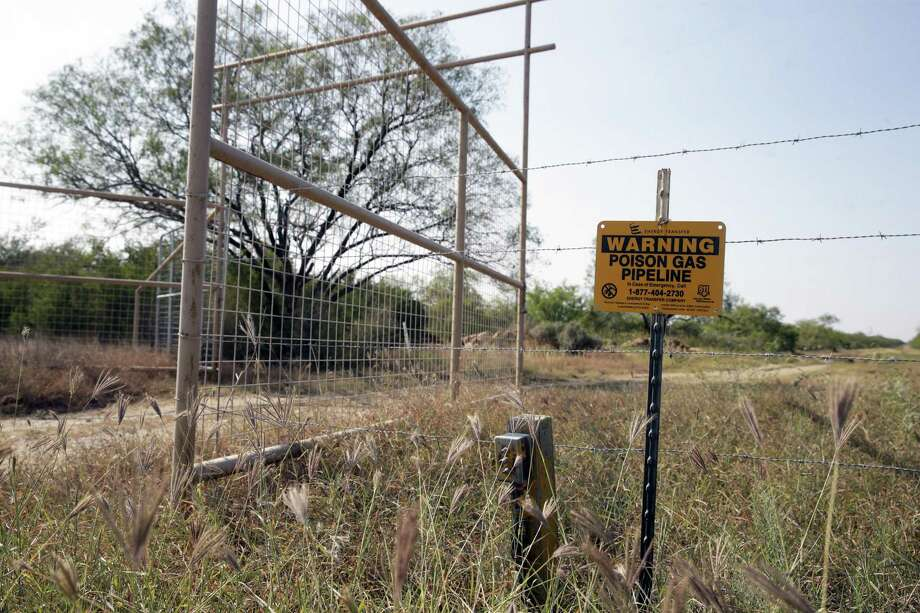 A sign, reportedly placed after the accident, warns of danger as Meghan and Steve Arnold show parts of their home on September 12, 2017 affected by poisonous gas leaking onto their property as a result of a nearby pipeline bursting on. Photo: Tom Reel, Staff / San Antonio Express-News / 2017 SAN ANTONIO EXPRESS-NEWS