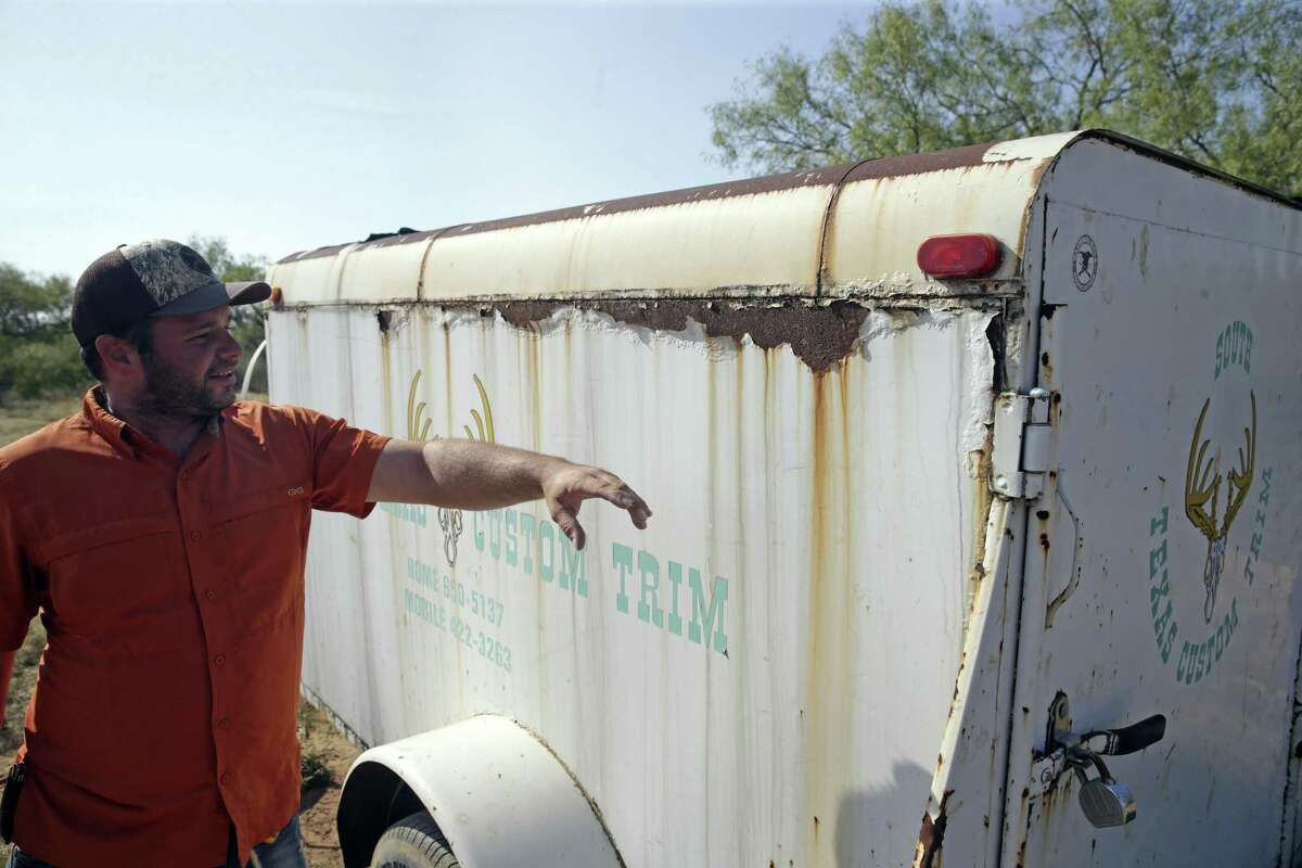 A trailer shows signs of corrosion as Meghan and Steve Arnold show parts of their home on September 12, 2017 affected by poisonous gas leaking onto their property as a result of a nearby pipeline bursting on.