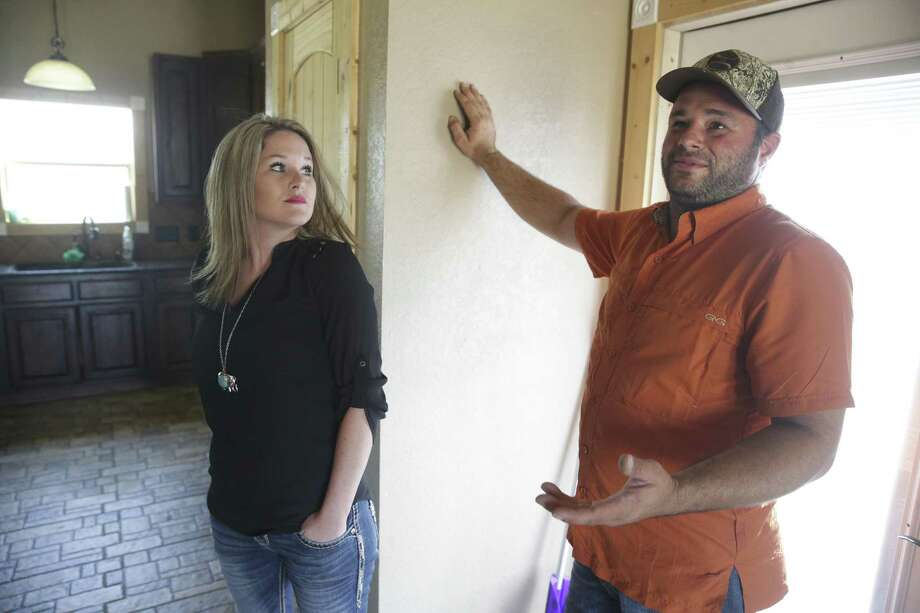 Meghan Arnold and Steve Woytasczyk talk Sept. 12 about the event as they show parts of their home on affected by poisonous gas leaking onto their property as a result of a nearby pipeline bursting. Photo: Tom Reel /San Antonio Express-News / 2017 SAN ANTONIO EXPRESS-NEWS