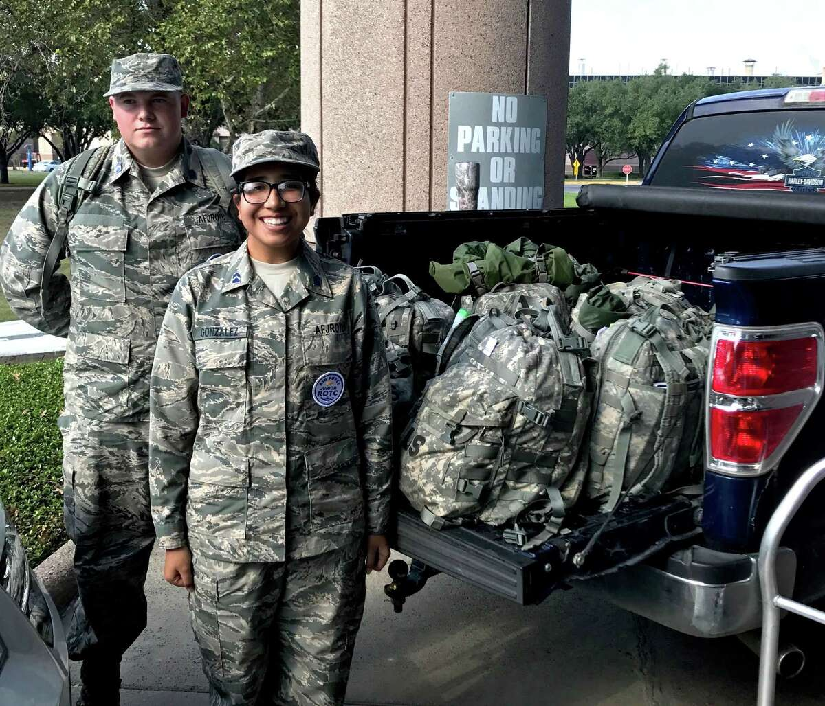 Cadet Major Dylan Watrous and Cadet Major Nohemi Gonzalez load up a truck with backpacks for homeless military veterans. The bags were delivered to the Houston VA where they will be distributed to those in need.