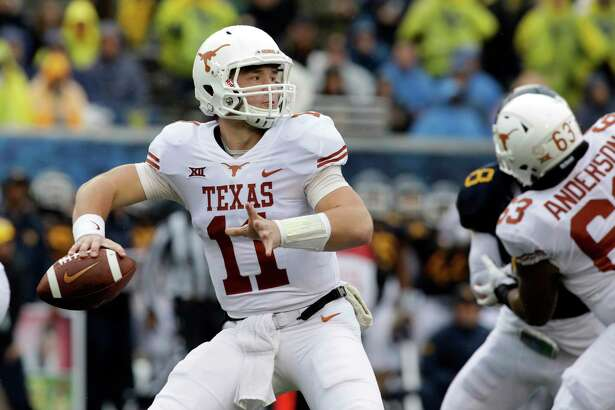 Texas quarterback Sam Ehlinger (11) throws a pass during the first half of an NCAA college football game against West Virginia, Saturday, Nov. 18, 2017, in Morgantown, W.Va. (AP Photo/Raymond Thompson)