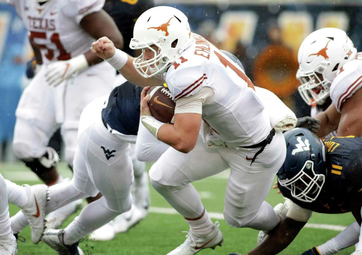 Texas quarterback Sam Ehlinger (11) is tackled by West Virginia linebacker David Long Jr. (11) during the first half of an NCAA college football game, Saturday, Nov. 18, 2017, in Morgantown, W.Va. (AP Photo/Raymond Thompson)