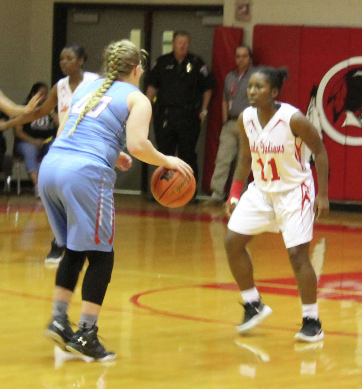 Jaszimine Johnson (right) of the Lady Indians plays defense against an incoming Lady Raider in possession of the ball.