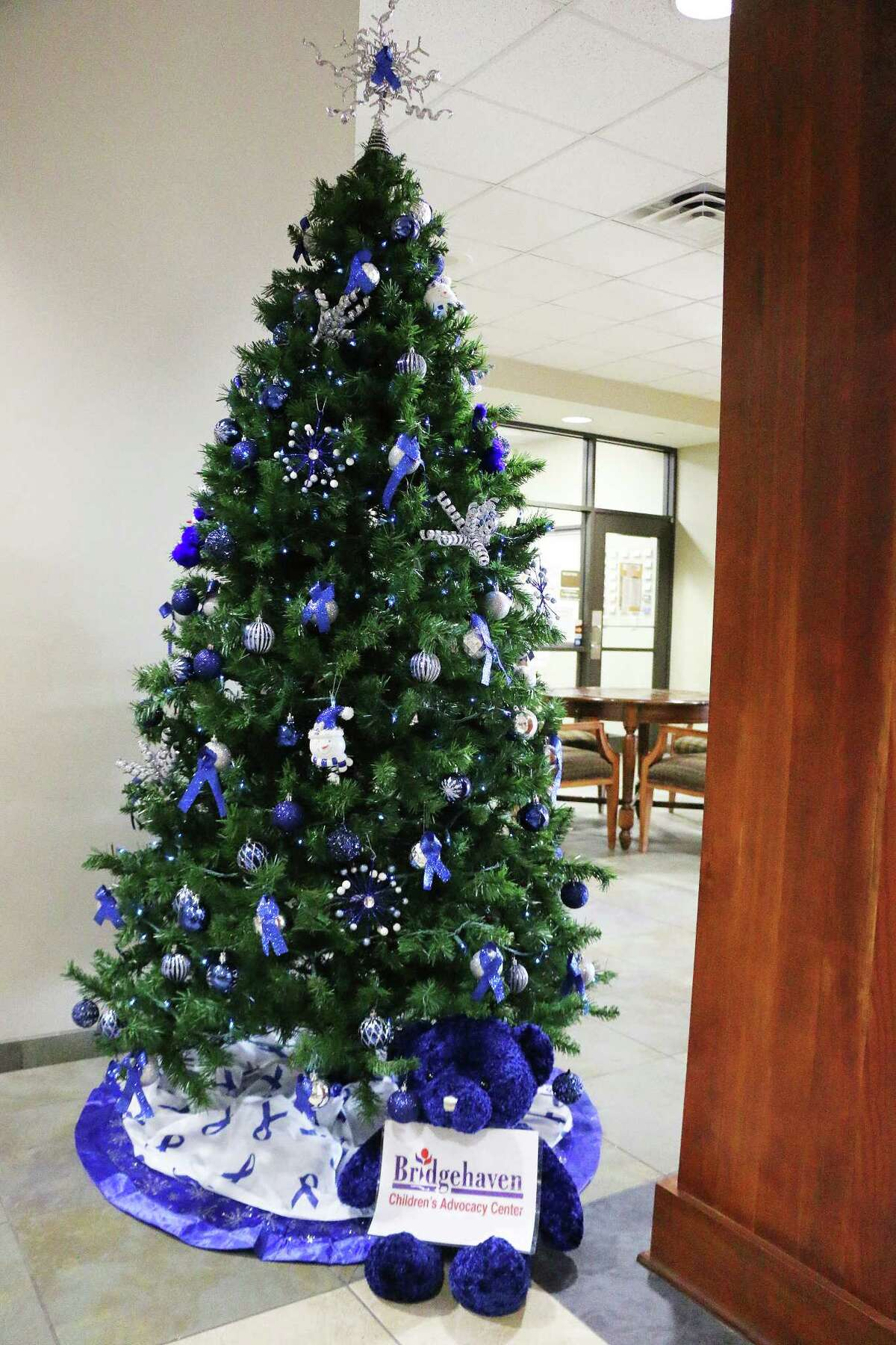 Always trying to brighten the lives of children, Bridgehaven sponsored this beautiful, icy blue tree with a childrenÂ?'s favorite Â?- a teddy bear.