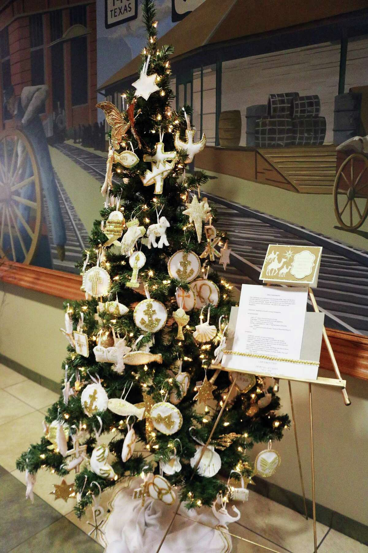This spectacular tree is covered with Chrismons, Christmas decorations with Christian symbols on them. They help Christians to remember that Christmas is the celebration of Jesus's birthday. They are often used on Christmas Trees in churches and Christians homes and this tree is sponsored by Dovetail Antiques.