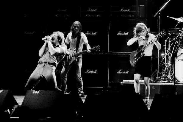 (FILES) This file photo taken on September 15, 1984 shows (LtoR) singer Brian Johnson performing next to guitarists Malcolm Young and Angus Young of Australian legendary hard rock band AC/DC at the Palais Omnisport of Paris Bercy, on September 15, 1984 in Paris. AC/DC guitarist and cofounder Malcolm Young has died aged 64, the band announced on November 18, 2017.  / AFP PHOTO / JEAN-CLAUDE COUTAUSSEJEAN-CLAUDE COUTAUSSE/AFP/Getty Images