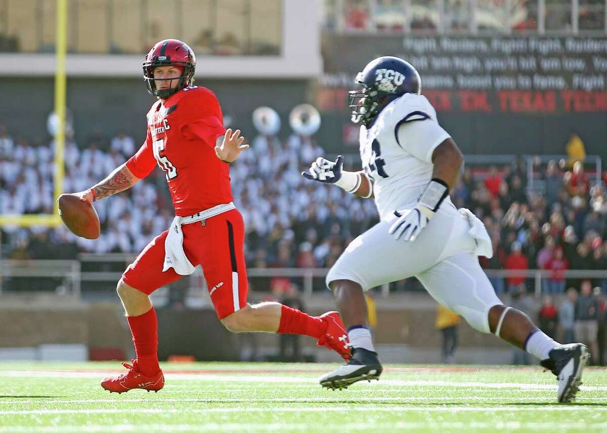 Texas Tech's Nic Shimonek (16) runs away from TCU's Joseph Broadnax Jr. during the first half of an NCAA college football game, Saturday, Nov. 18, 2017, in Lubbock, Texas. (AP Photo/Brad Tollefson)