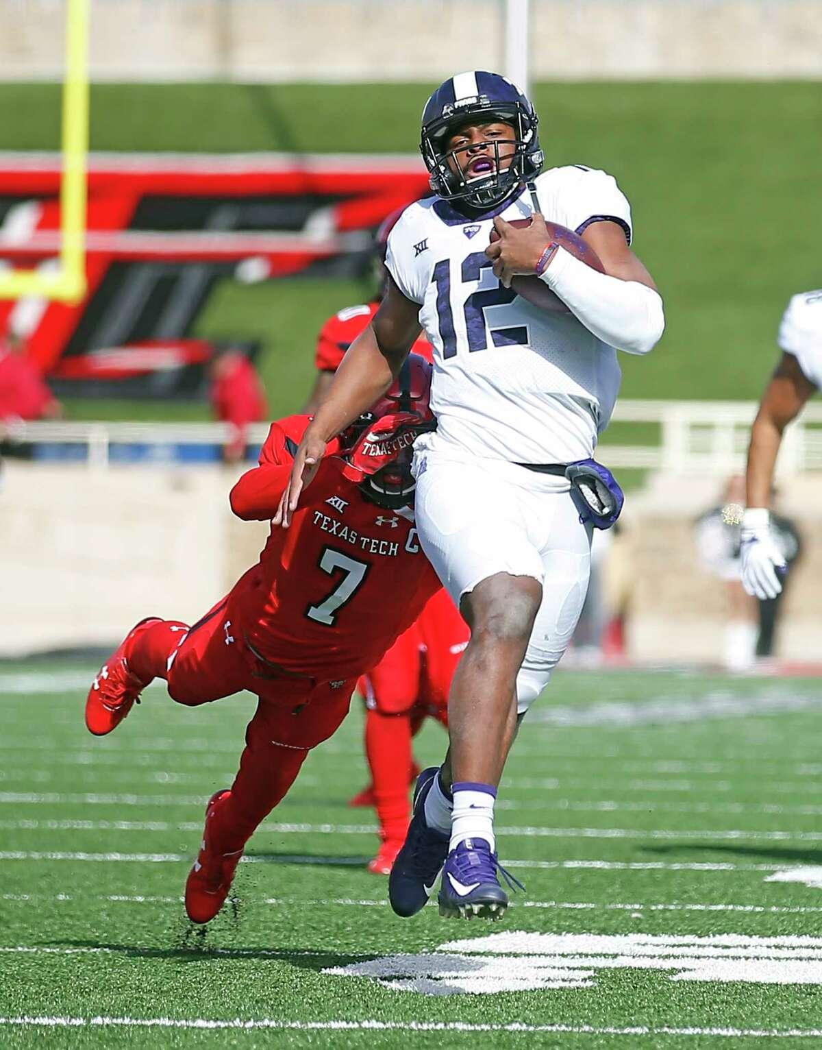 TCU's Shawn Robinson (12) runs away from Texas Tech's Jah'Shawn Johnson (7) during the first half of an NCAA college football game, Saturday, Nov. 18, 2017, in Lubbock, Texas. (AP Photo/Brad Tollefson)