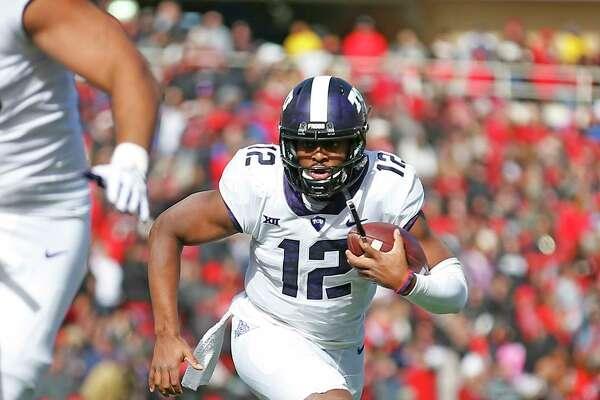 TCU's Shawn Robinson (12) runs down the field during the first half of an NCAA college football game against Texas Tech, Saturday, Nov. 18, 2017, in Lubbock, Texas. (AP Photo/Brad Tollefson)