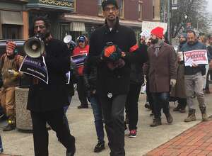 Several people gathered in Troy on Saturday, Nov. 18, 2017,  to protest treatment of two people shot by police in the city in recent years (Lisa Lewis)