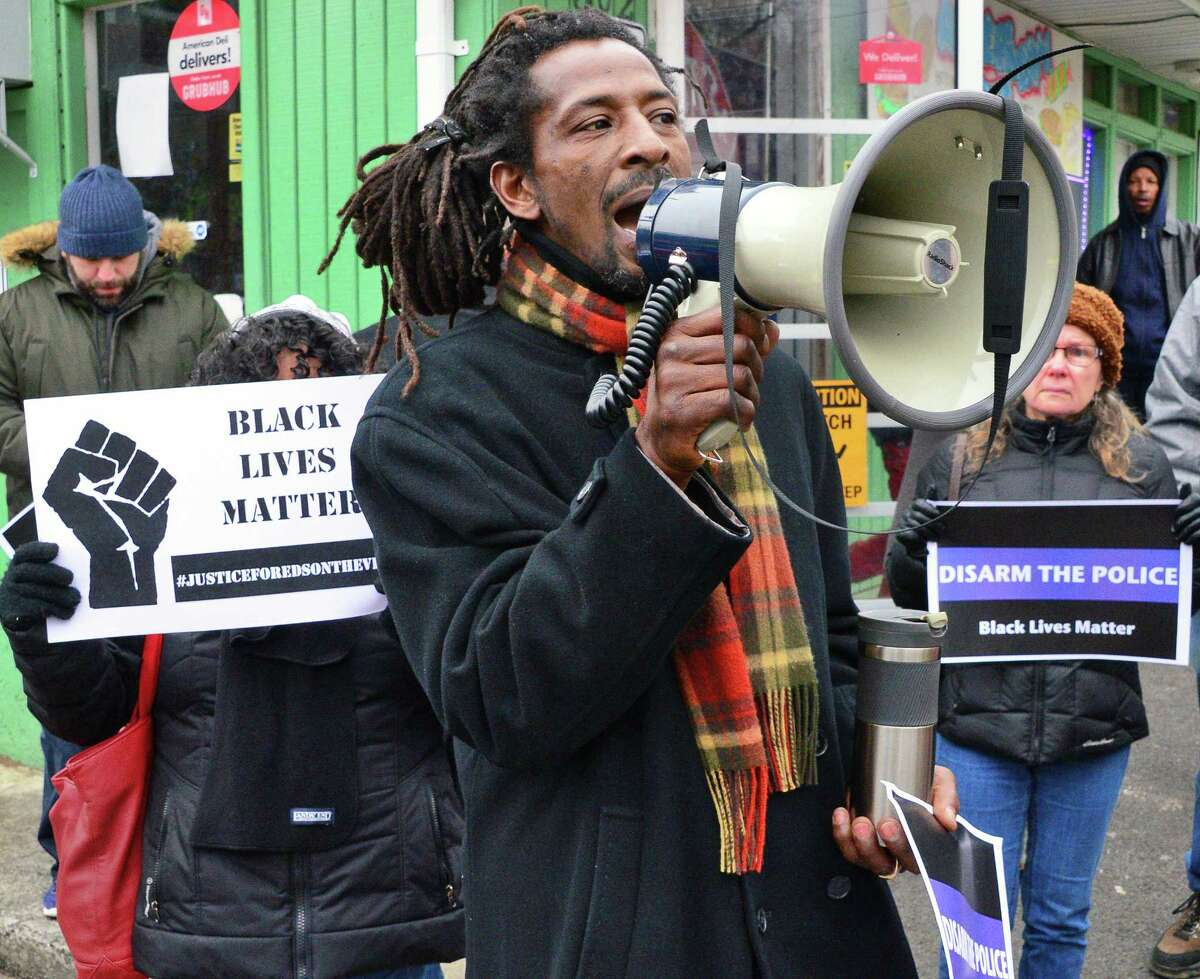 Dahmeek McDonald's uncle, identified only as Messiah leads a rally to draw attention to the police killing of Edson Thevenin and shooting of Dahmeek McDonald and to call for the use of a civilian review board Saturday Nov. 18, 2017 in Troy, NY. (John Carl D'Annibale / Times Union)
