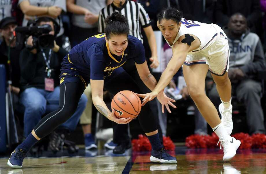 UConn's Gabby Williams, right, tries to steal the ball from California's Penina Davidson on Friday. Photo: Brad Horrigan / Hartford Courant / Hartford Courant