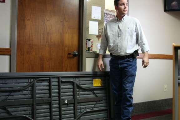 Prairie Baptist Church Associate Pastor John Woullard helps barricade a door at an intruder awareness and response training Nov. 11, 2017, at the church in Scotts, Mich. RNS photo by Emily McFarlan Miller