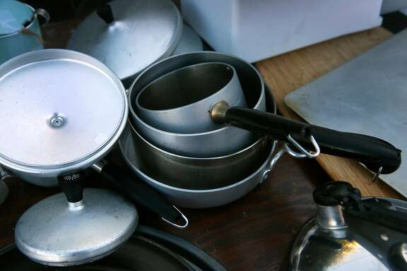 Cookware is available at a free garage sale for fire survivors at Diane Madero's home in Santa Rosa, Calif. on Saturday, Nov. 18, 2017. Madero came up with the idea to gather unused belongings from her home and make them available for free to residents who lost their homes in the Tubbs Fire.