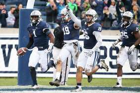 Yale's Malcolm Dixon (1) reacts after scoring a touchdown in the first half against Harvard at Yale Bowl on Saturday.