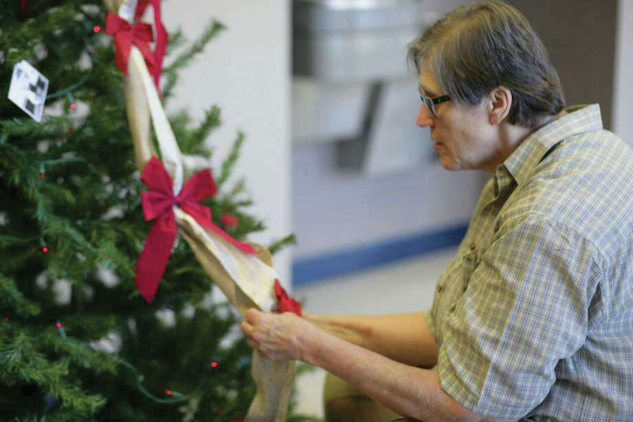 Last year for Hometown Christmas, members of the Cleveland Historical Society won first place for a Christmas tree adorned with photos of the late Moon Young. Photo: Vanesa Brashier