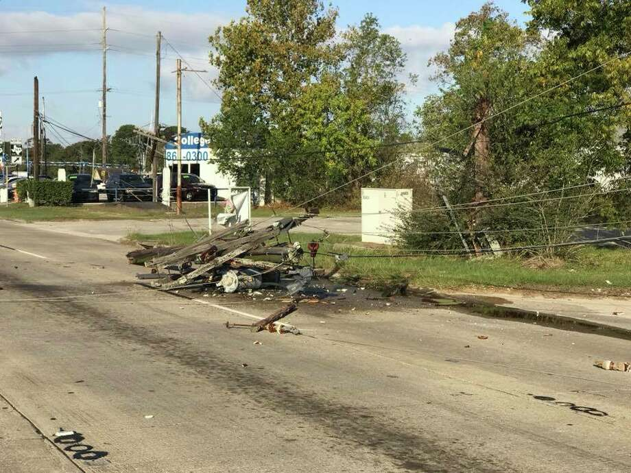 Two power poles were knocked down on College Street after a wreck Saturday. The street has since been reopened. Photo: Facebook