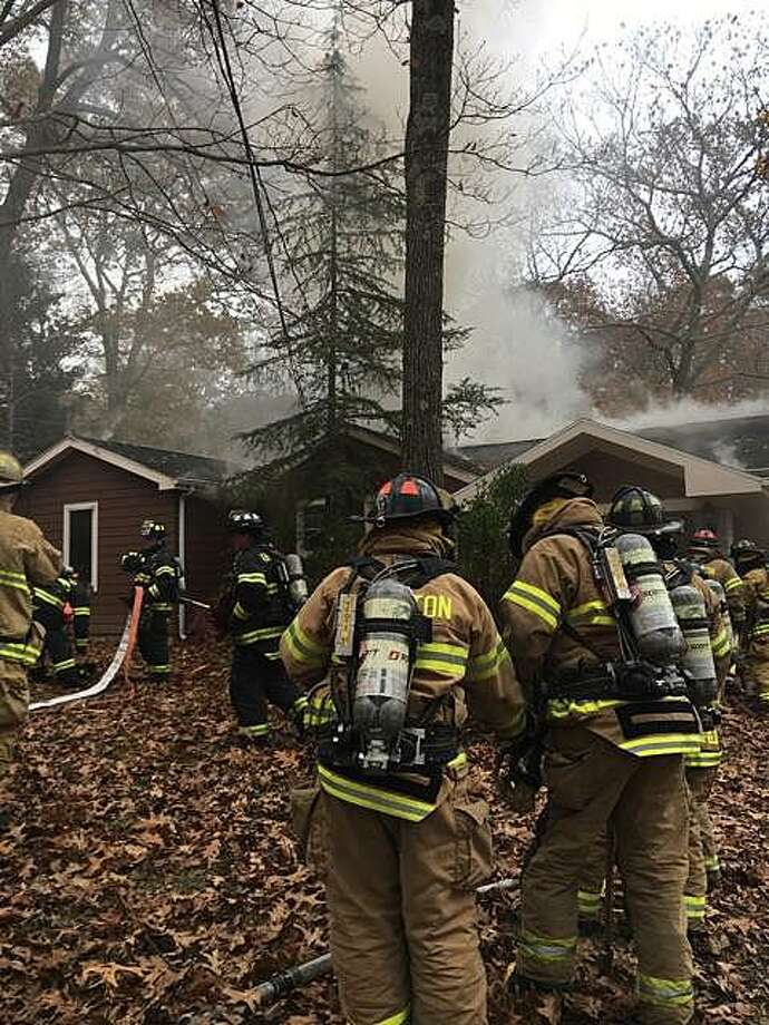 The fire tokk place on Saw Mill Road in Weston, Conn., around 1 p.m. on Nov. 18, 2017. Weston Fire Department said the first units to respond saw heavy fire and smoke from the back of the residence. Since Saw Mill Road runs through Weston and Fairfield, the Fairfield Fire Department responded as well. Photo: Contributed Photo / Weston Fire Department / Contributed Photo / Connecticut Post Contributed