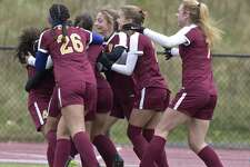 St Joseph's celebrates a goal in the Girls Soccer Class L championship game between St. Joseph and RHAM high schools on Saturday morning, November 18, 2017, at Middletown High School, in Middletown, Conn.