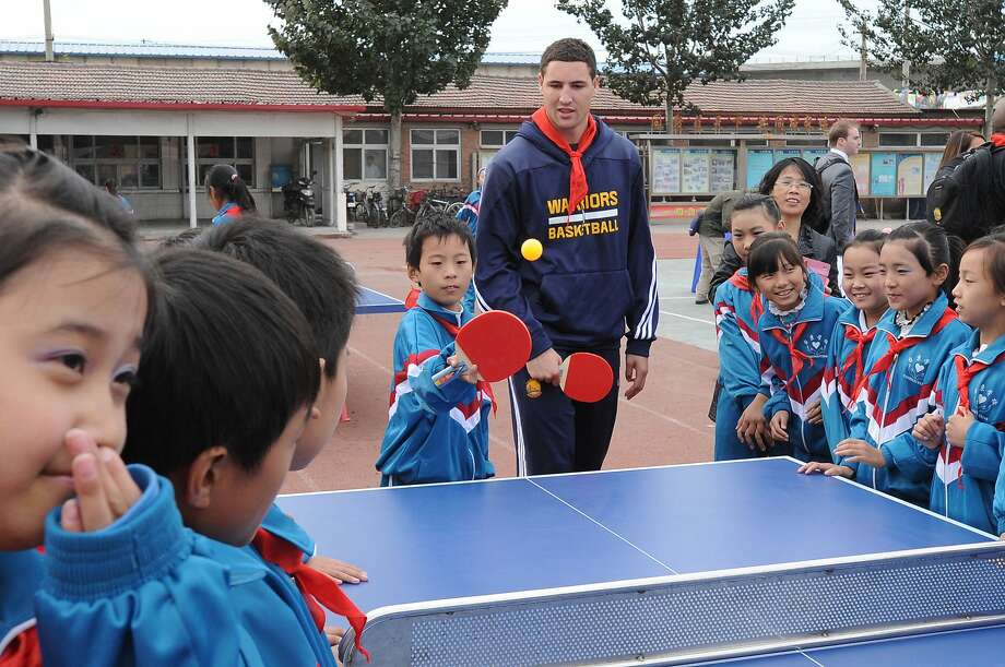 Klay Thompson of the Golden State Warriors interacts with the kids at the NBA Cares Reading and Learning Center as part of 2013 Global Games on October 14, 2013 at the Taijing Migrant School in Beijing, China. Photo: Courtesy Of NBAE/Getty Images, NBAE/Getty Images
