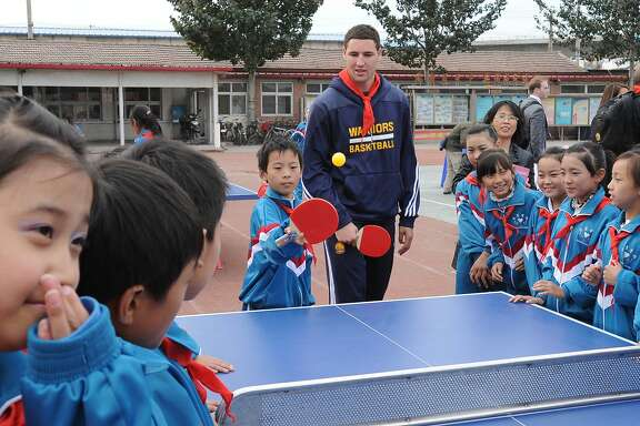 Klay Thompson of the Golden State Warriors interacts with the kids at the NBA Cares Reading and Learning Center as part of 2013 Global Games on October 14, 2013 at the Taijing Migrant School in Beijing, China.