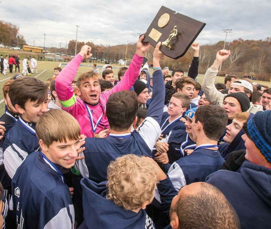 Morgan goaltender Anes Gadun celebrates winning the Class S boys soccer championship with his teammates and fans Saturday in Waterbury. Photo: John Vanacore / For Hearst Connecticut Media / (c)John H.Vanacore/For Hearst Connecticut Media