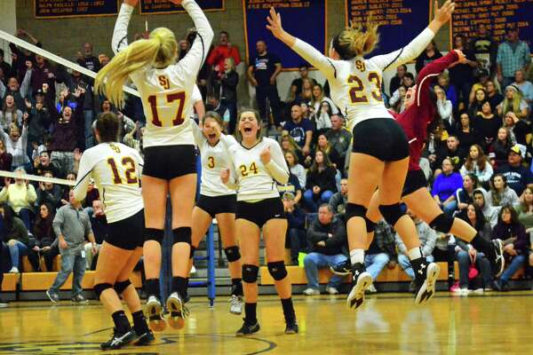 St. Joseph celebrates its win over East Haven in Class M volleyball finals action in East Haven, Conn. on Saturday Nov. 18, 2017.