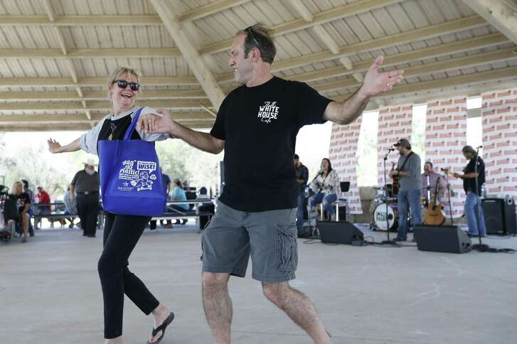 Newlywed couple Peggy and John Bayer dance under the pavilion to music by local musical group Small Town Habit as the San Antonio River Authority hosts the 3rd Annual Pecan Jubilee & Dessert Bake-Off Contest at John William Helton-San Antonio River Nature Park near Floresville on Saturday, Nov. 18, 2017. The event featured a dessert bake-off where the community was encouraged to submit their favorite pecan-themed baked goods. Other activities included a car show, games and rides, baking demonstrations by St. Philip's College, food trucks, an art and antique market provided by Finders Keepers Market and live musical entertainment by Billy Morgan & The Barn Burners and Small Town Habit. (Kin Man Hui/San Antonio Express-News)
