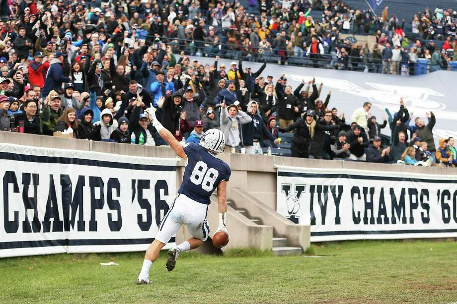 Yale's JP Shohfi points to the crowd after scoring a touchdown in the first half against Harvard on Saturday. The announced crowd for 'The Game' was 51,426. Photo: Adam Glanzman / Getty Images / 2017 Getty Images