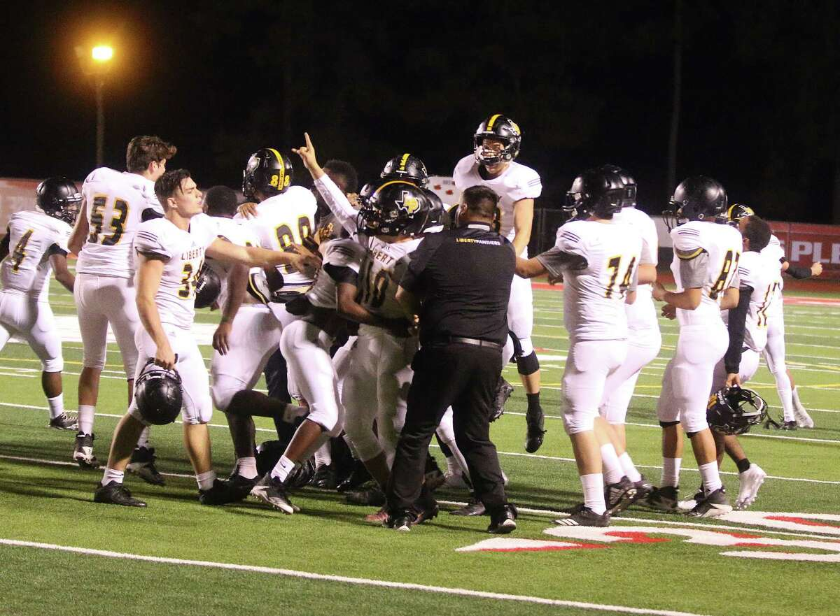 Panther players and coaches mob junior Jesus Landeverde after he booted the game winning field goal against the Shepherd Pirates giving Liberty a 31-28 victory. The Panthers advance to the next round of the playoffs.