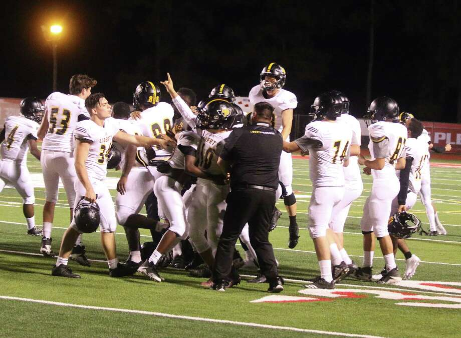 Panther players and coaches mob junior Jesus Landeverde after he booted the game winning field goal against the Shepherd Pirates giving Liberty a 31-28 victory. The Panthers advance to the next round of the playoffs. Photo: David Taylor