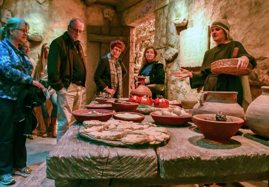 Visitors listen to a living history interpreter at the Museum of the Bible, which opened its doors to the public Saturday in the nation's capital city. / The Washington Post