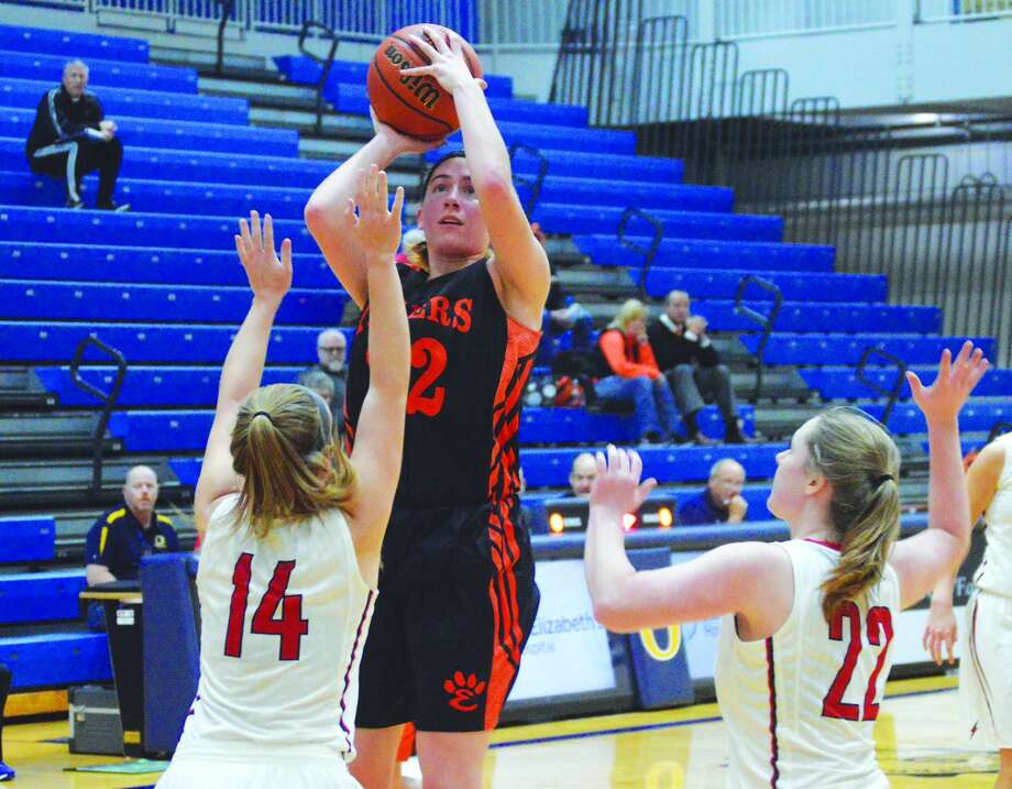 EHS senior guard Kate Martin goes up for a jump shot with two Chatham Glenwood players defending her in the first quarter Saturday in O'Fallon.